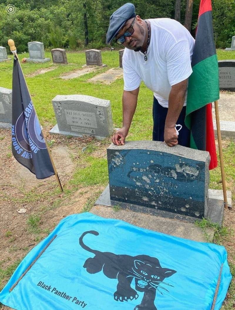 The tombstone of Black Panther Party Chairman Fred Hampton, Sr., which is shot up annually by officers in Haynesville, LA.