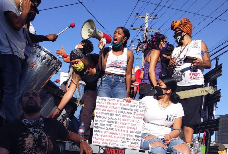 Simone Jacques (with bullhorn), organizer of a youth-led protest against police violence, speaks during a march from Mission High School to San Francisco's Hall of Justice on June 3, 2020.