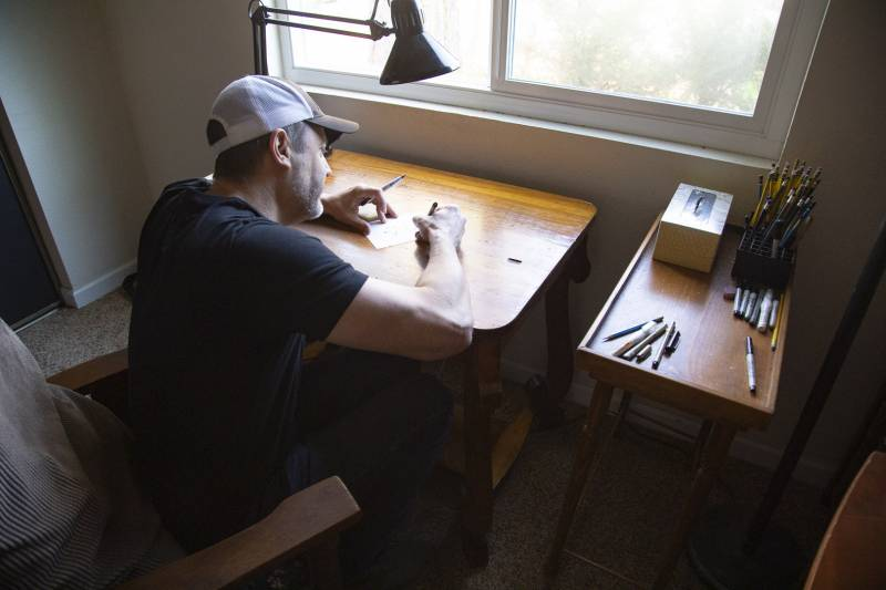 Stephan Pastis draws a quick sketch at his studio on Saturday, Sept. 19, 2020. The cartoonist prefers to work on a flat surface using a short chair.