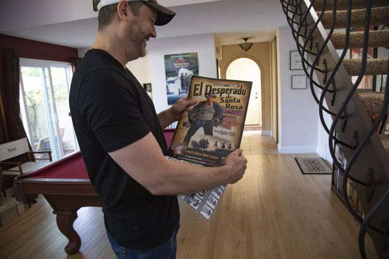 Stephan Pastis flips through his book 'Pearls Goes Hollywood.' Pastis says he enjoyed making small nod at Santa Rosa in the book's pull-out poster.