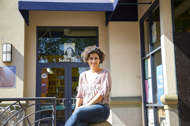 Restaurant owner Reem Assil sits in front of Reem's California in Oakland on Sept. 29, 2020. Assil closed the restaurant's Fruitvale location to the public and now uses it to provide food for vulnerable communities affected by the 2020 global pandemic.