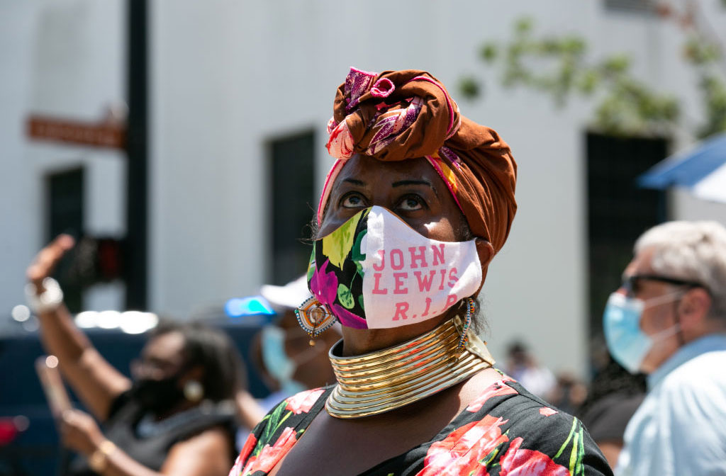 Wearing a John Lewis mask, Marion Glaser travelled from Mississippi to view the funeral procession of civil rights icon, former US Rep. John Lewis (D-GA) on July 26, 2020 in Montgomery, Alabama.