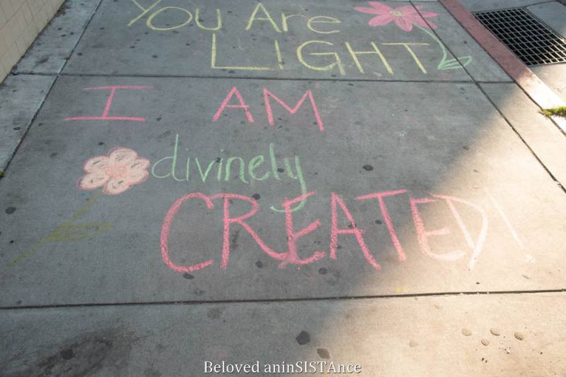 """You Are LIGHT"" and ""I AM divinely CREATED"" written in chalk on the sidewalk."