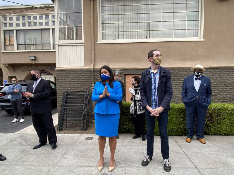 San Francisco Mayor London Breed and State Senator Scott Wiener look on solemnly during the community prayer.