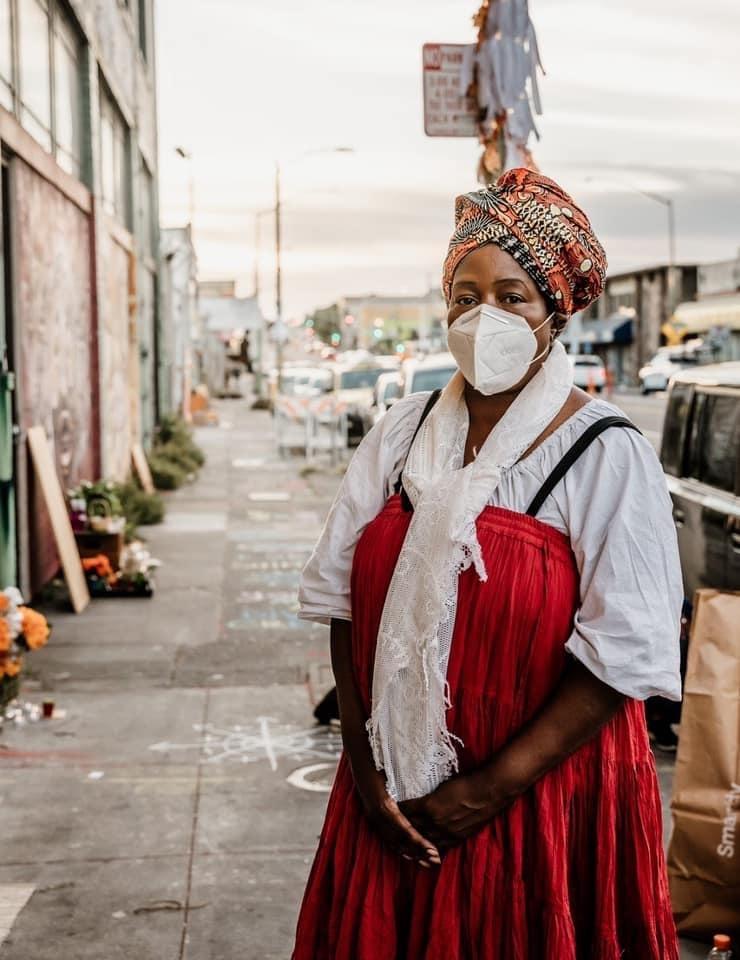 Regina Evans posing for a photo on International Blvd. in Oakland.