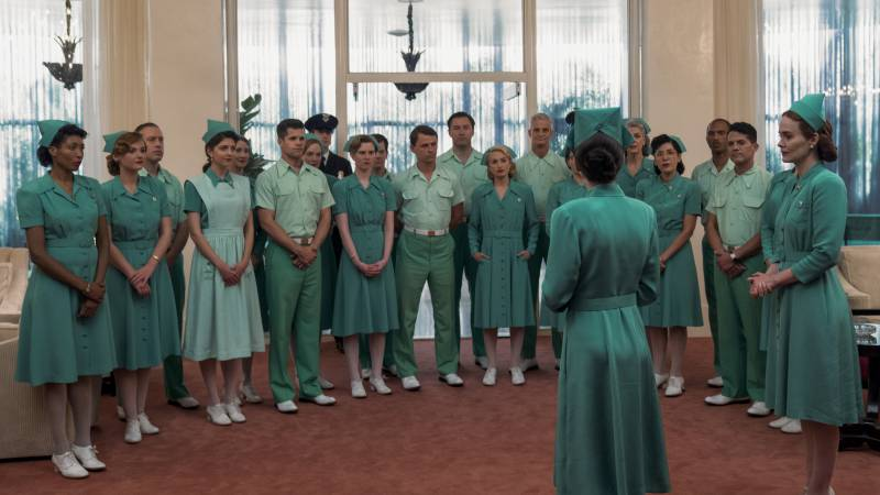 The staff assembles in front of Nurse Bucket (Judy Davis) in 'Ratched.'