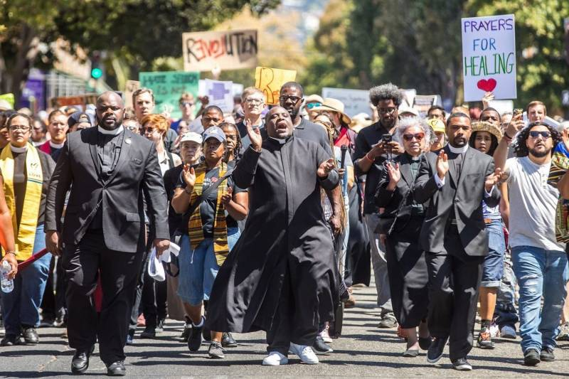 Pastor Michael McBride, center, leads a 2017 march in Berkeley to protest white supremacists.