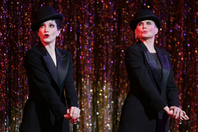 Ann Reinking (R) performing alongside Bebe Neuwirth (L) during a dress rehearsal in New York City for the 10th Anniversary of Broadway's 'Chicago.' November 14, 2006.