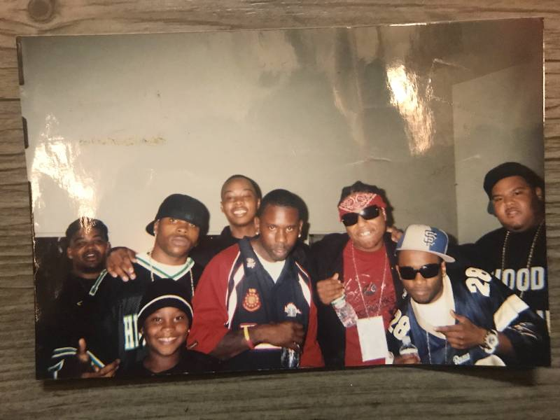 San Francisco rappers, including Ya Boy (sunglasses), San Quinn (center, far back), Bailey (Blue SF hat) and Big Rich (far right) pose for a photo at the Henry J. Kaiser Auditorium in Oakland. October 2005.