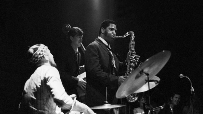 Sonny Rollins with Han Bennink, drums, and Ruud Jacobs, bass, in 1967, Arnhem, The Netherlands.