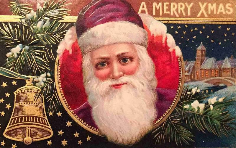 A Victorian Christmas card depicts Santa with large, mesmerizing eyes and fluffy white beard.