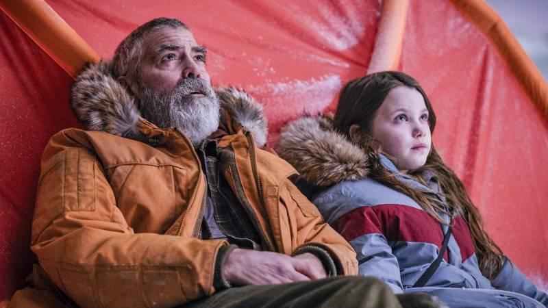 George Clooney and Caoilinn Springall, right, in a scene from the sci-fi film Clooney directed, 'The Midnight Sky.'