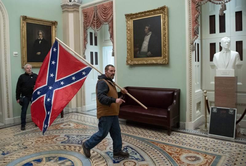 A confederate flag-waver inside the US Capitol Rotunda on Jan. 6, 2021.