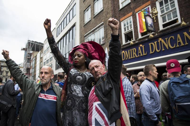 Londoners, gathered outside the Admiral Duncan pub as part of a vigil for the victims of the Pulse nightclub mass shooting in Florida, June 2016.