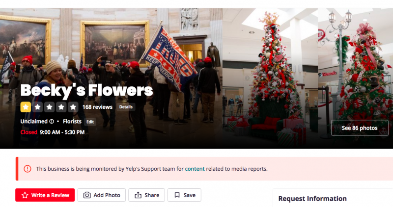 The Becky's Flowers Yelp page is currently dominated by a photo that appears to show owner, Jenny Cudd, inside the Capitol Building, draped in a Trump flag.