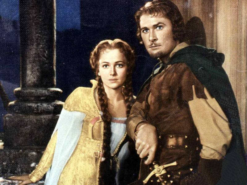 Errol Flynn and Olivia de Havilland, starring in 1938's 'The Adventures of Robin Hood.' Not to be confused with the Robinhood stock app.
