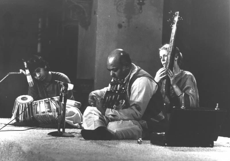 Tabla player Zakir Hussain (left) accompanies sarod player Ali Akbar Khan and his wife and collaborator Mary Khan.