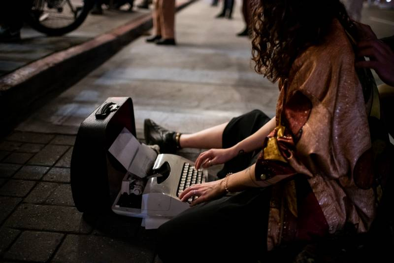 Deborah Drozd writes on a typewriter during a vigil for Lawrence Ferlinghetti at City Lights Books on Feb. 23, 2021.