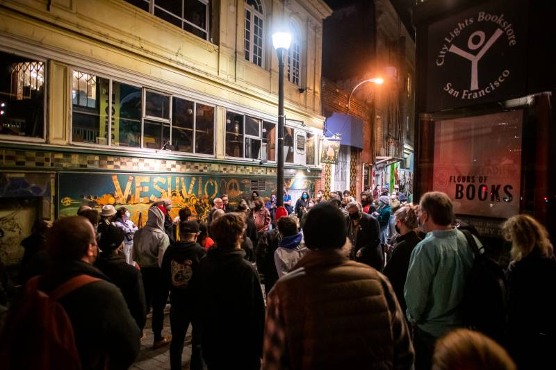 A vigil and poetry reading is held outside of City Lights Books in San Francisco for its founder Lawrence Ferlinghetti on Tuesday Feb. 23, 2021, who died on Monday at the age of 101. Friends and fellow poets shared remembrances, read his work and raised their glasses.