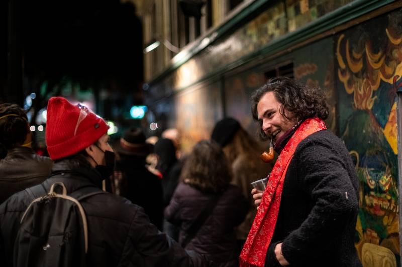 Scott Bird (right) during a vigil for Lawrence Ferlinghetti outside of City Lights Books on Feb. 23, 2021.