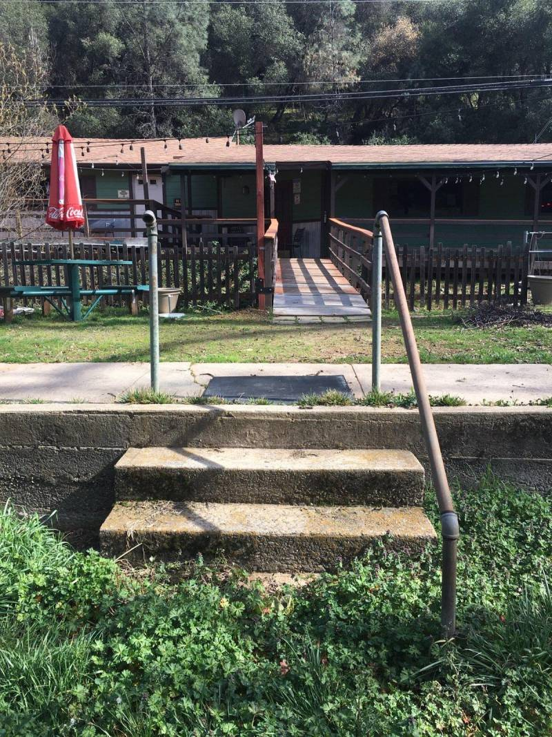Old stairs from the swimming pool remain on the lawn outside the Dew Drop Inn.