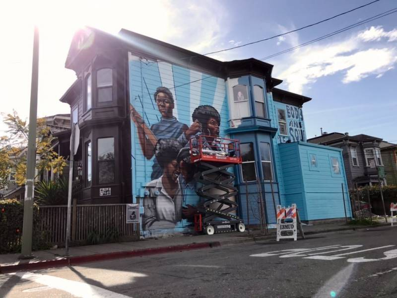 A two-story home on Center street and 9th street in West Oakland is now home to a mural dedicated to the women of the Black Panther Party. Artwork by Rachel Wolfe-Goldsmith.