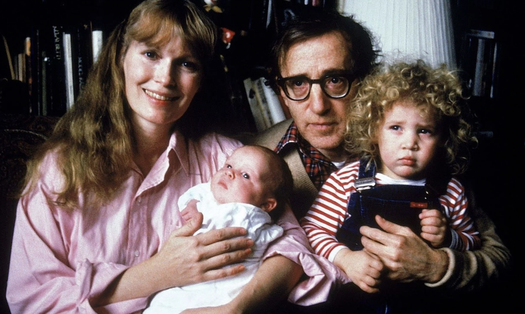 Mia Farrow and Woody Allen at home with newborn Ronan (née Satchel) Farrow, and their adopted daughter, Dylan.