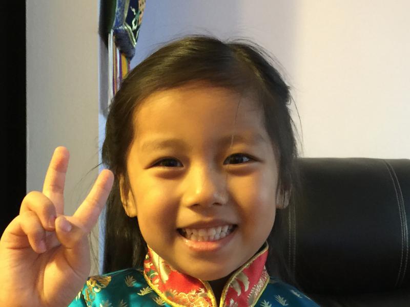 Tibetan-American Tsojung Yerutsang, 9, celebrating Tibetan New Year.