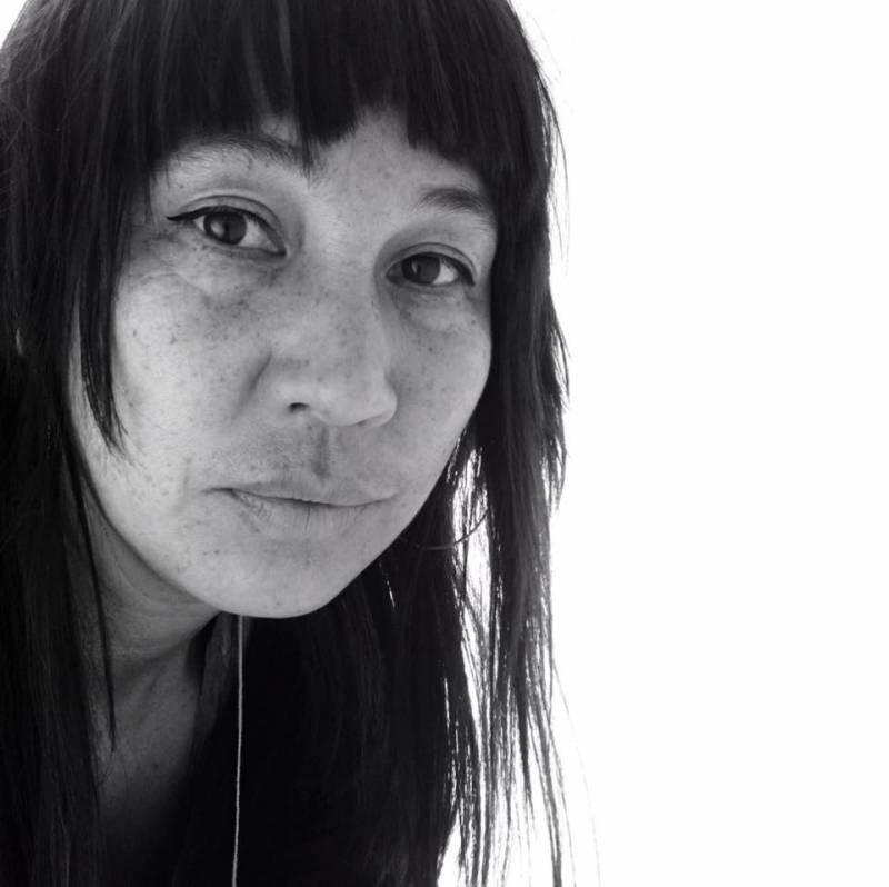 A black and white portrait of activist archivist, Moriah Ulinskas