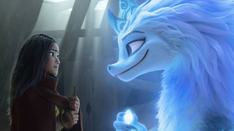 Raya, a young warrior princess (Kelly Marie Tran), enlists the help of Sisu, a friendly water dragon (Awkwafina) in 'Raya and the Last Dragon.'