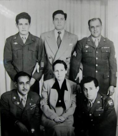 Enriqueta Andaloza surrounded by her sons, all World War II veterans. L-R: Joe Ramírez (kneeling), Edgardo Ramírez, John Ramírez, Abraham Salgado (her son-in-law) and Paul Ramírez.