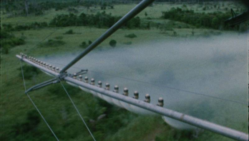 A helicopter sprays agent orange in Vietnam in a scene from 'The People vs. Agent Orange.'