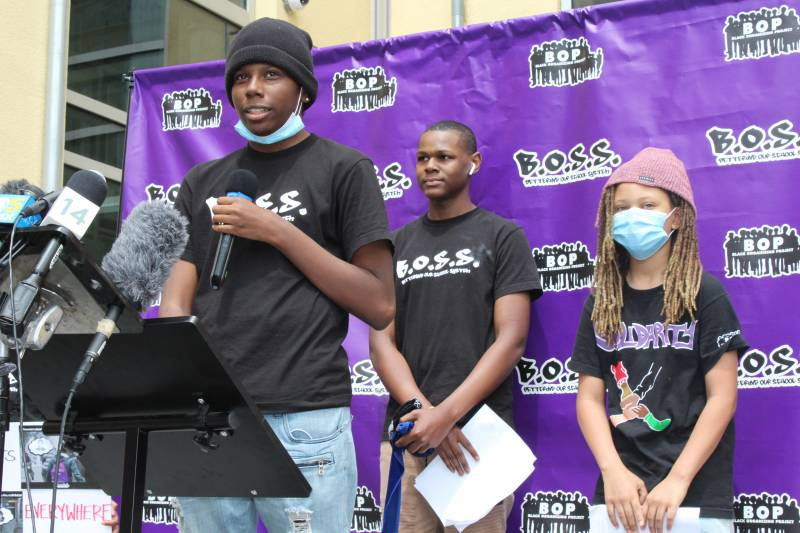 Youth organizers Charles Knight, Brandon Coles and Imani Snodgrass (L–R) appear at a press conference in June 2020, a week before the vote to eliminate Oakland's school police force.
