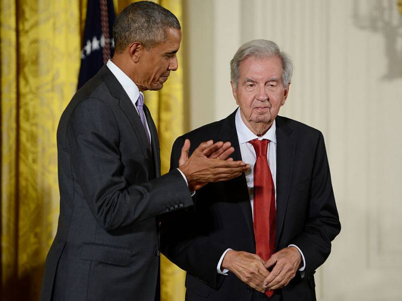 President Barack Obama presents novelist, essayist and screenwriter Larry McMurtry with the 2014 National Humanities Medal at The White House on September 10, 2015 in Washington, DC.