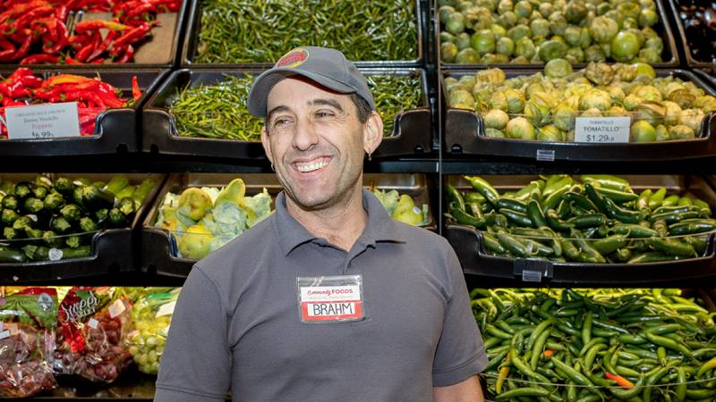 Community Foods CEO Brahm Ahmadi poses in the produce section
