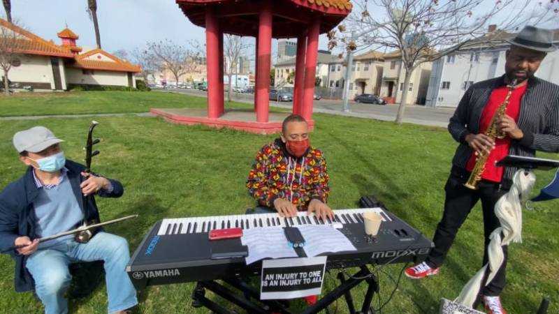 "Tao Shi, Kev Choice and Howard Wiley (L–R) perform in Chinese Garden Park in Oakland. Adding an ehru to his jazz ensemble was ""a powerful example of solidarity,"" says Choice."