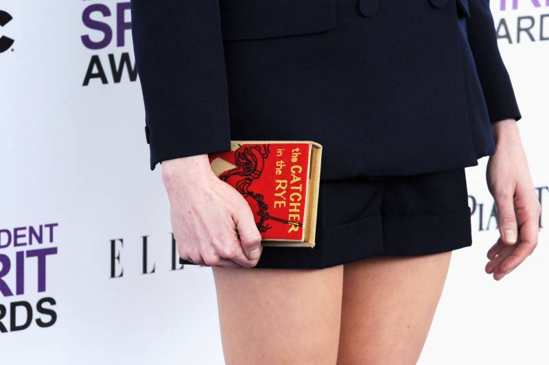Actress Michelle Williams arrives at the 2012 Independent Spirit Awards clutching a 'Catcher in the Rye' accessory.