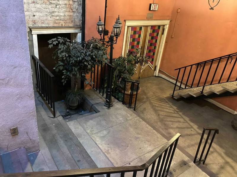 Plants on the ground floor, put in place by Anne Bishop, after a Feng Shui expert advised her that something bad had happened in the area. Drew Washer saw an apparition heading to the area early one morning as she set up her shop.