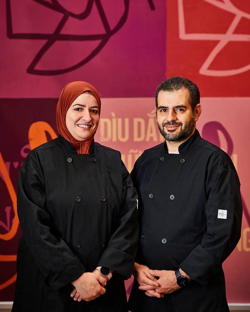 Wafa (left) and Mounir Bahloul pose inside the La Cocina Municipal Marketplace