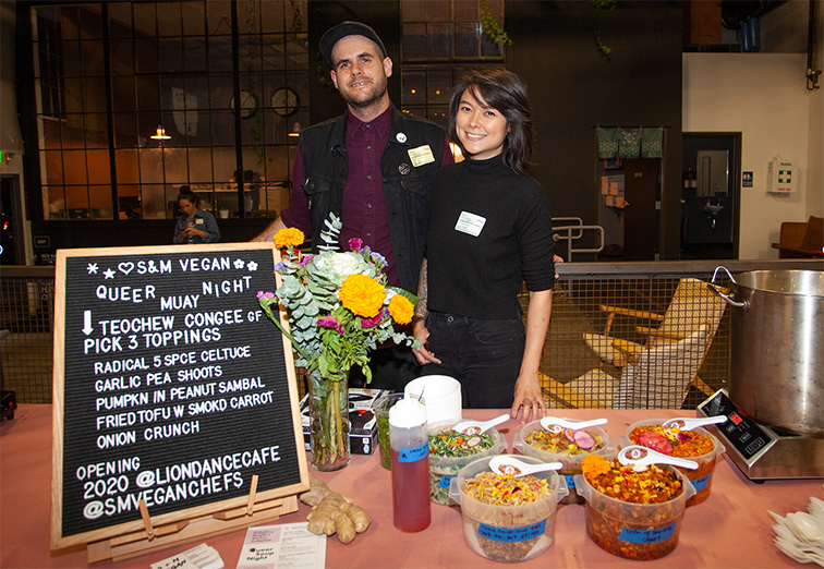 Shane Stanbridge (left) and CY Chia pose in front of the chalkboard menu at an earlier pop-up incarnation of their restaurant.
