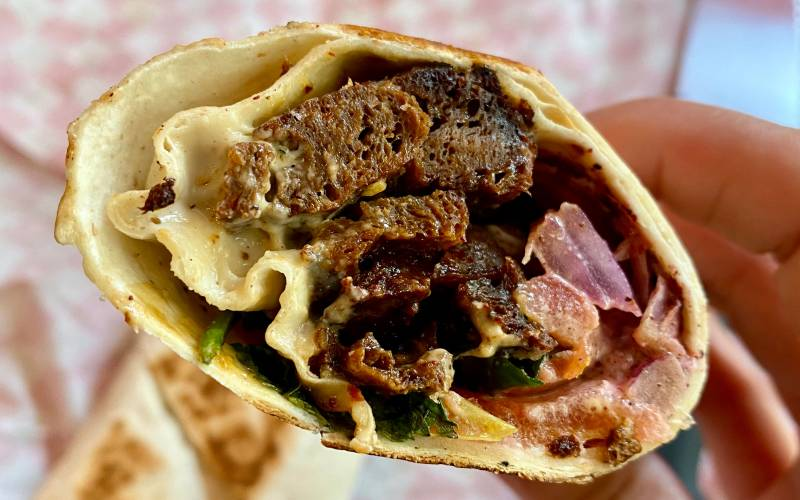 Close-up shot of the cross section of Lion Dance Cafe's seitan-based vegan shawarama.
