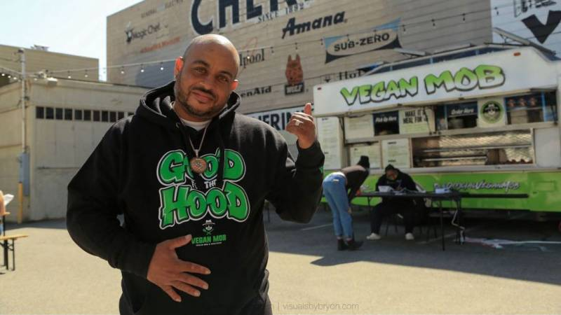 Vegan Mob owner Toriano Gordon stands in front of his Vegan Mob truck in a new food court in the Mission District.