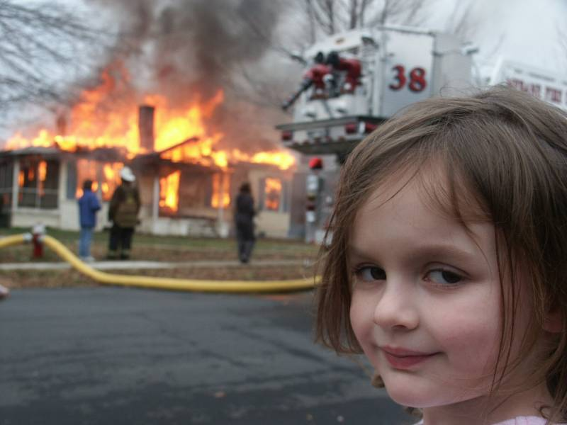 A 4-year-old Zoë Roth in front of a burning building. The photo became a popular meme.