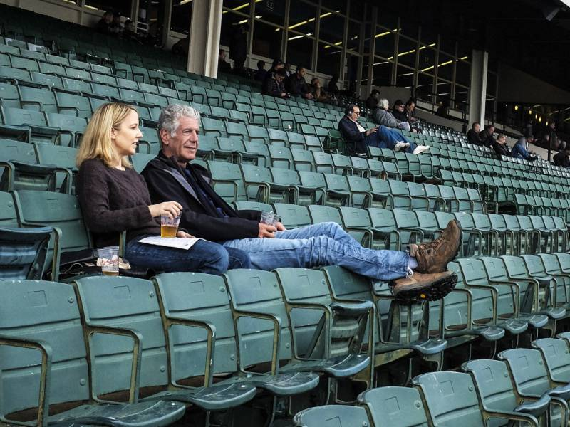 Laurie Woolever and Anthony Bourdain at the Aqueduct Racetrack in Queens, N.Y.