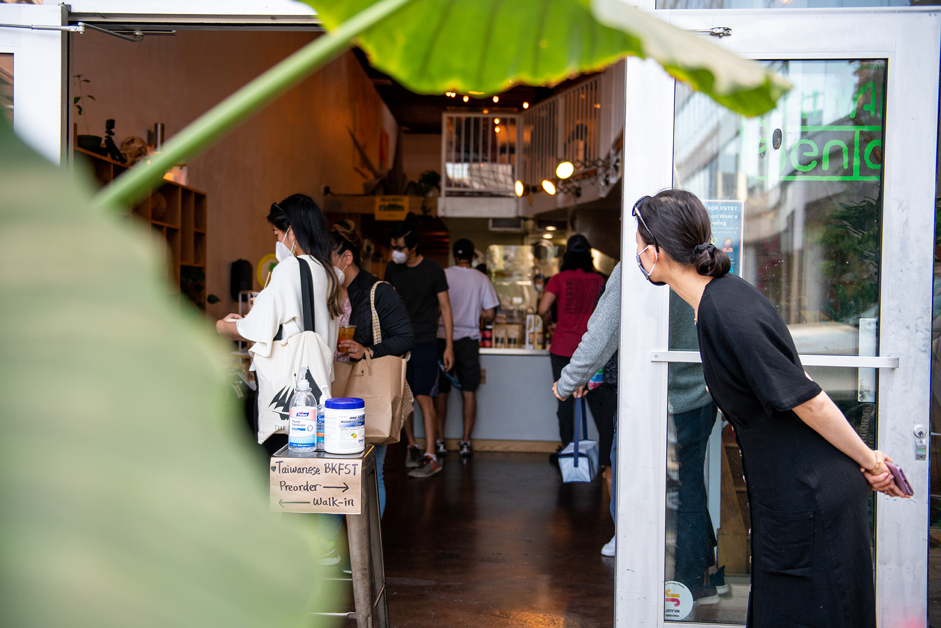 A customer leans in to peeks inside Taiwan Bento as she waits her turn during the restaurant's Taiwanese breakfast pop-up.
