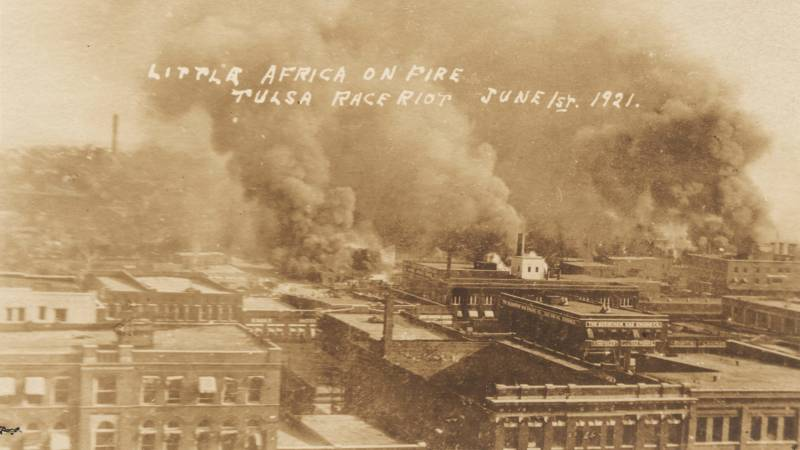 """Graphic photos of the Tulsa Race Massacre were turned into postcards and distributed by some white people. This one is labeled: """"Little Africa on Fire, Tulsa Race Riot, June 1, 1921."""""""