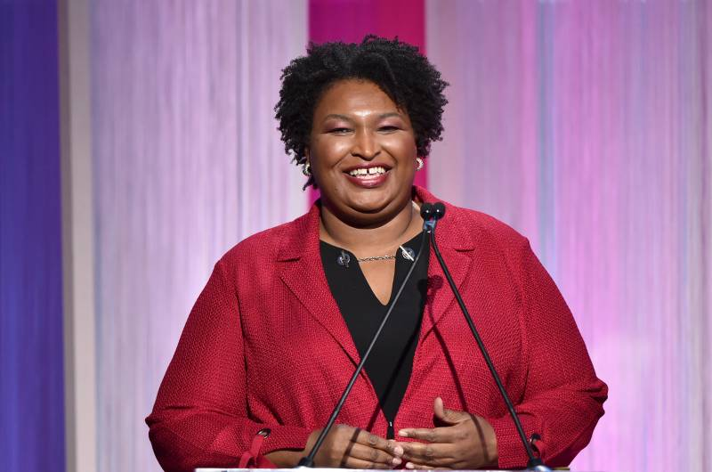 Stacey Abrams smiles at a 'Hollywood Reporter' event, 2019.