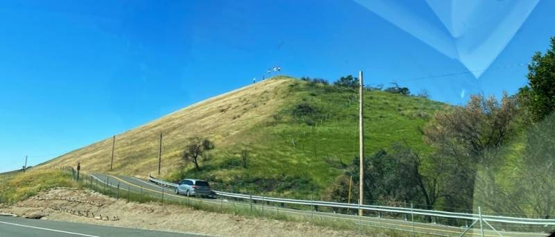 The grass on hill near Cherry Glen Road in Vacaville, turning from green to brown.