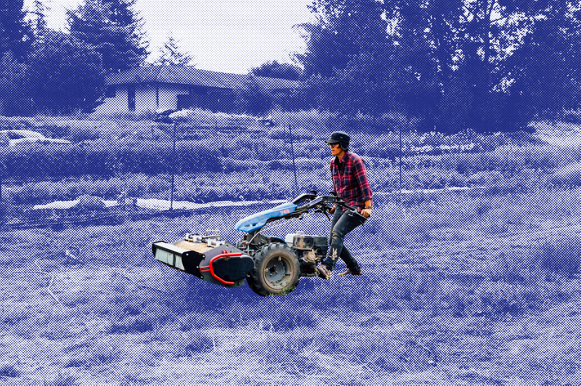 Leslie Wiser pushes a plow in a field; the backdrop of the field is shaded blue.