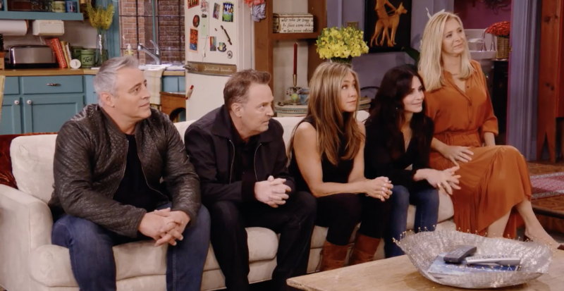 The cast of 'Friends' look at an off-screen David Schwimmer during HBO's reunion special. (L-R) Matt LeBlanc, Matthew Perry, Jennifer Aniston, Courteney Cox and Lisa Kudrow.